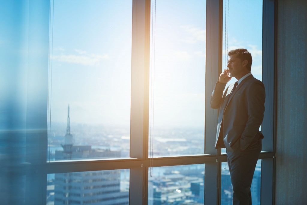 Man talking to the phone while in a high building