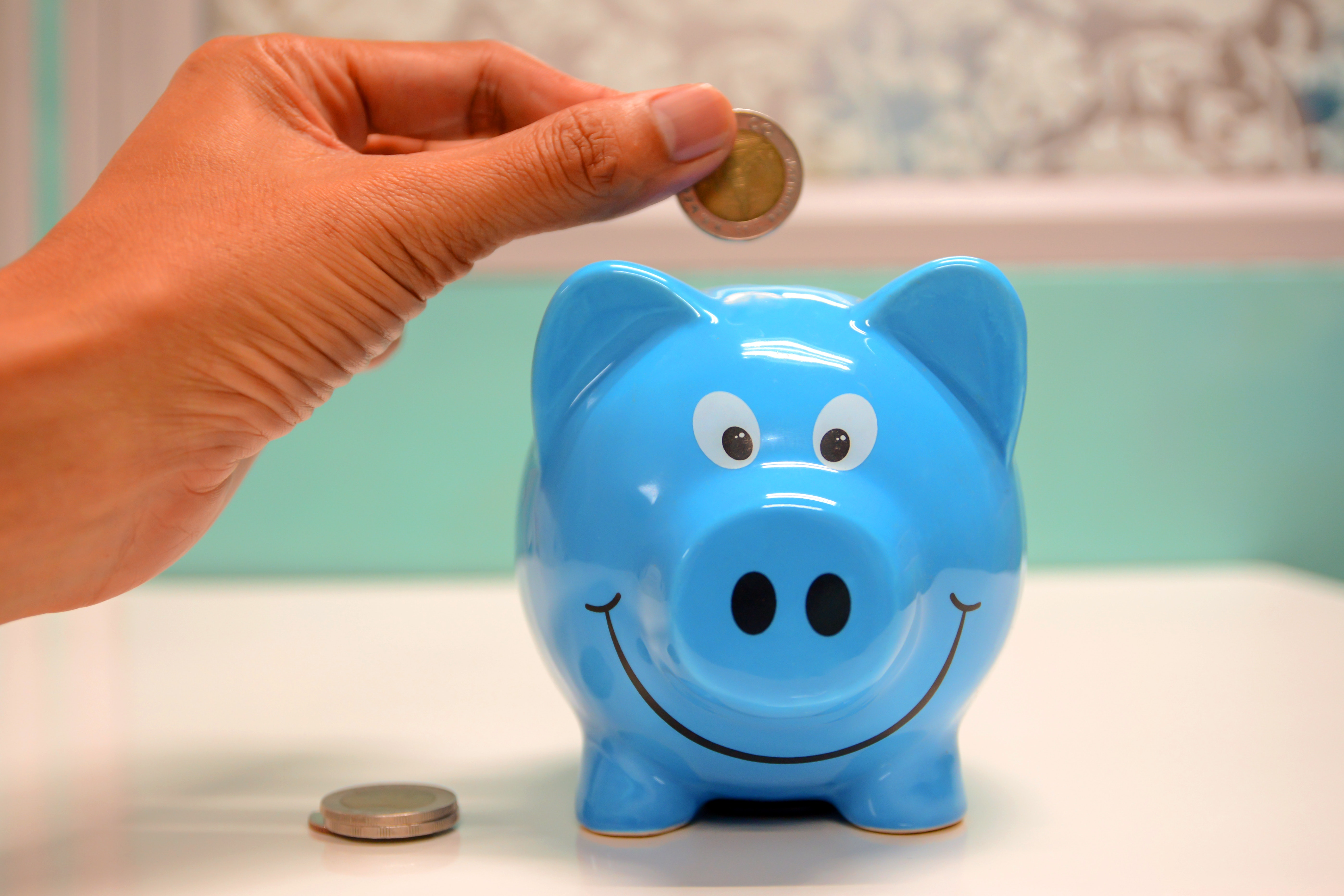 placing coin inside piggy bank