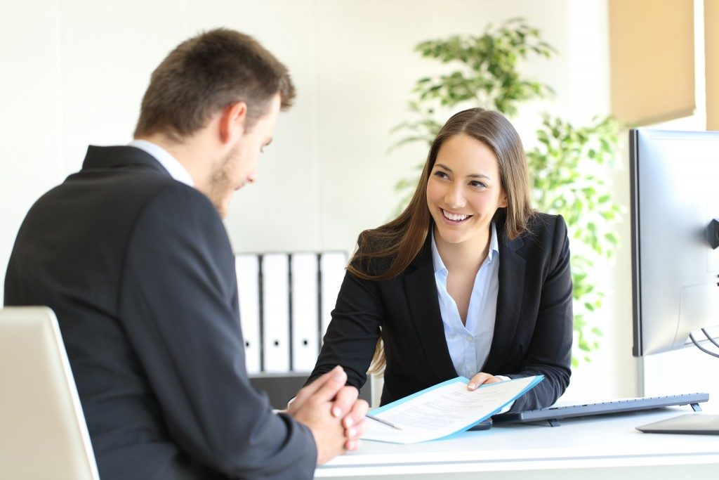 woman talking to client