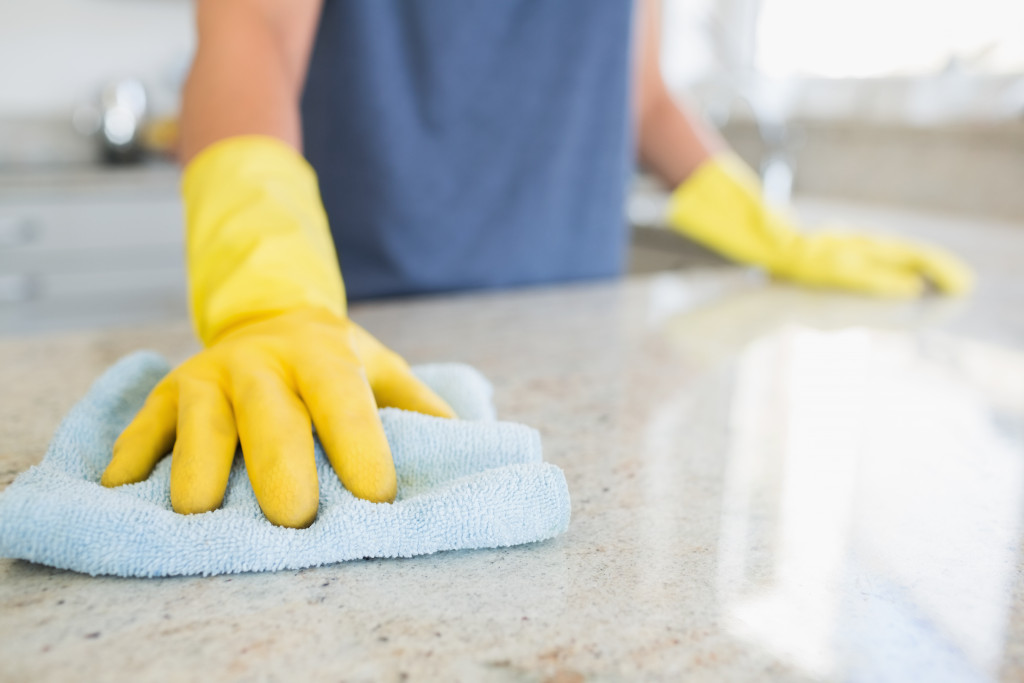 cleaning the counter in the kitchen