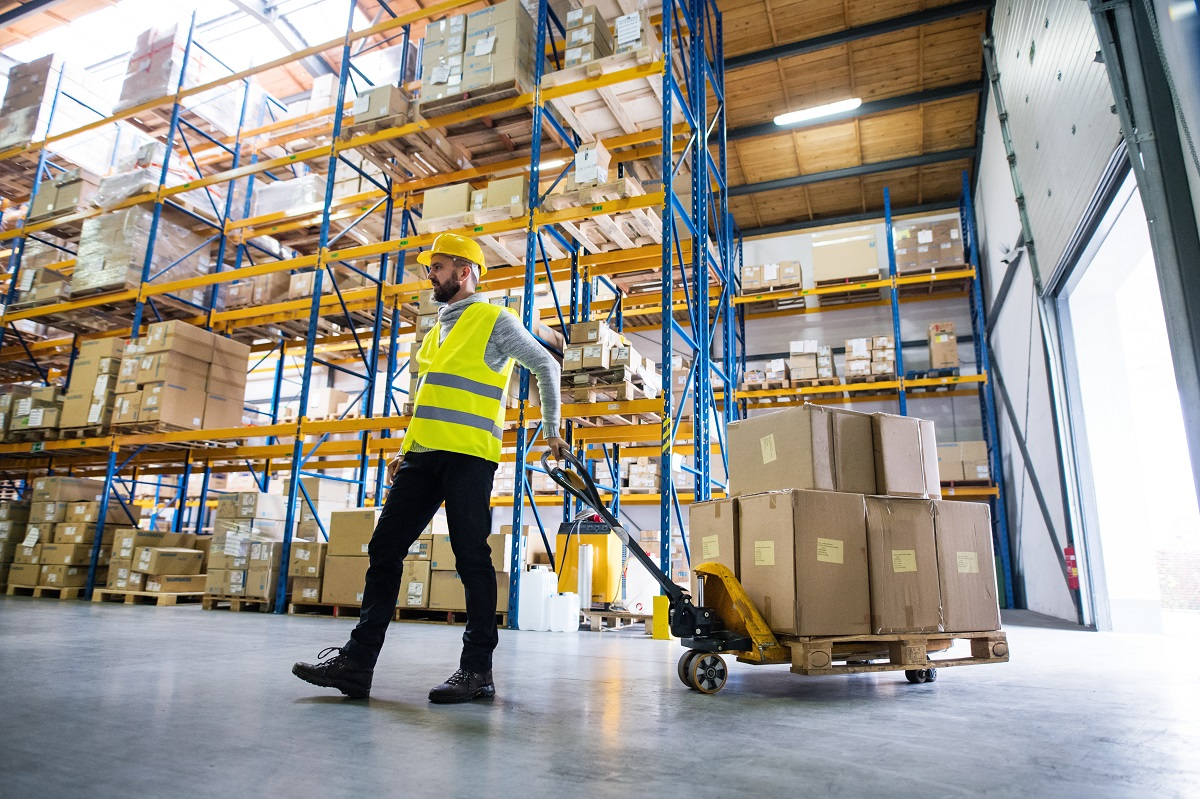 man pulling boxes in the warehouse