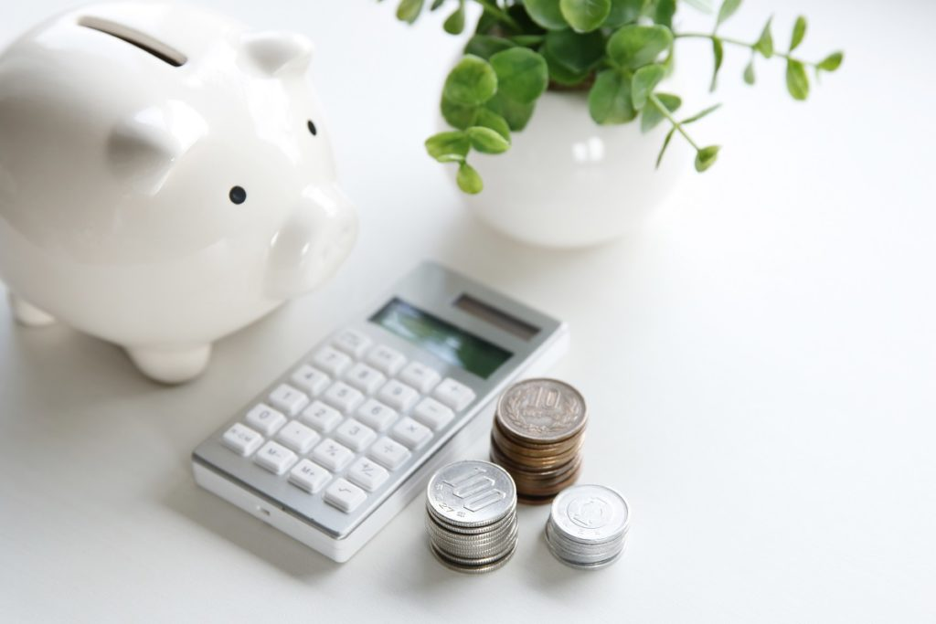 piggy bank, coins, and calculator
