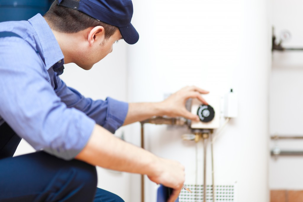 plumber checking heater