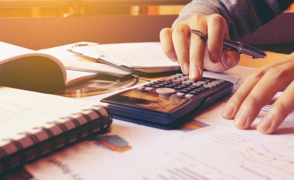 person computing a budget