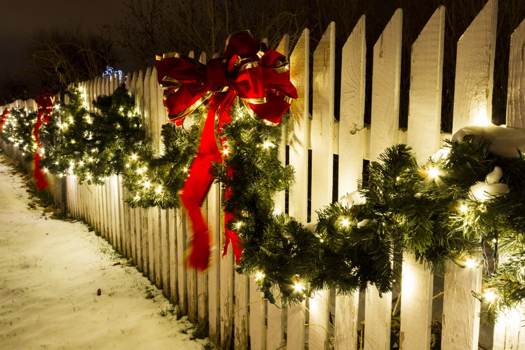 christmas decor on a fence