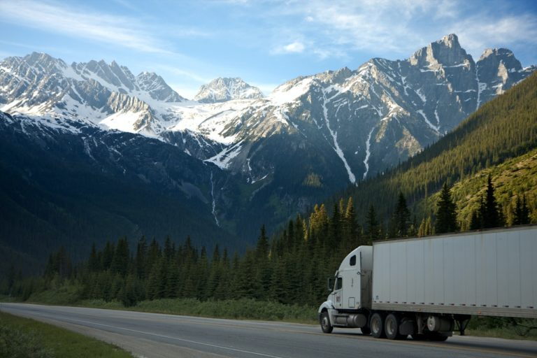 a truck on the road near a mountain