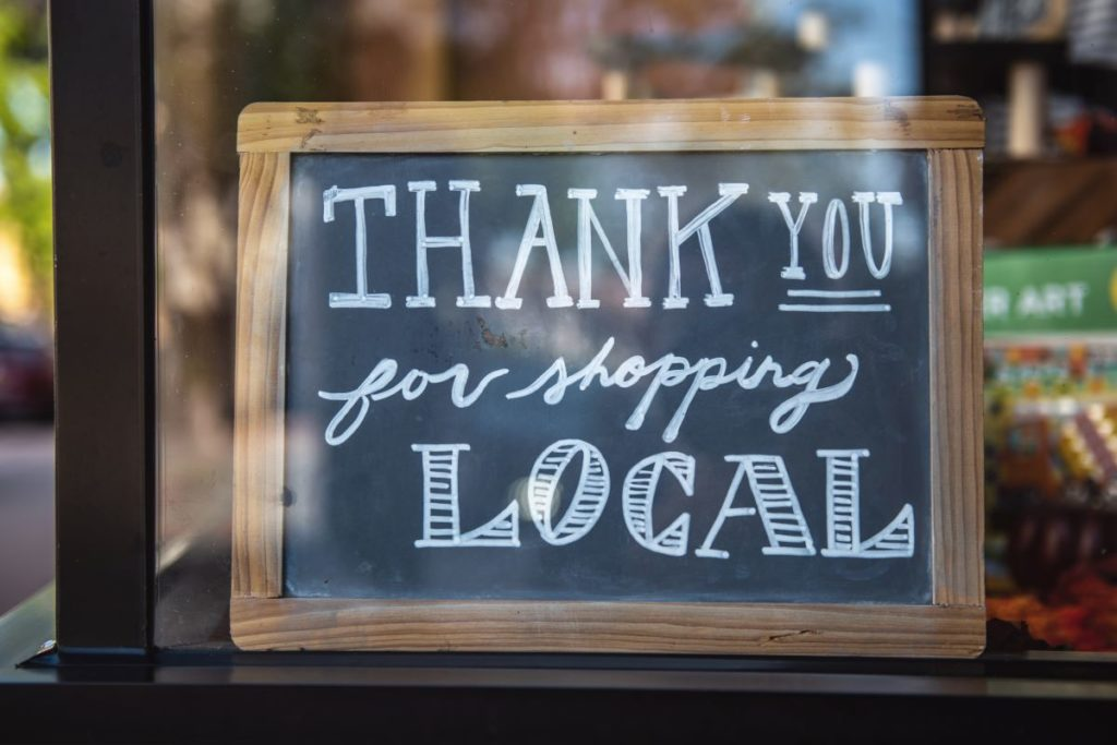 """sign that reads """"thank you for shopping local"""""""