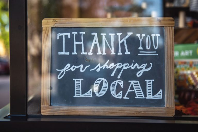 "sign that reads ""thank you for shopping local"""