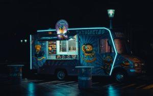 a stylish neon food truck