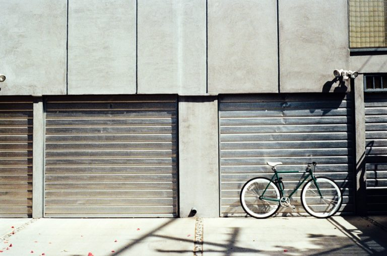 2 garage doors bike urban setting