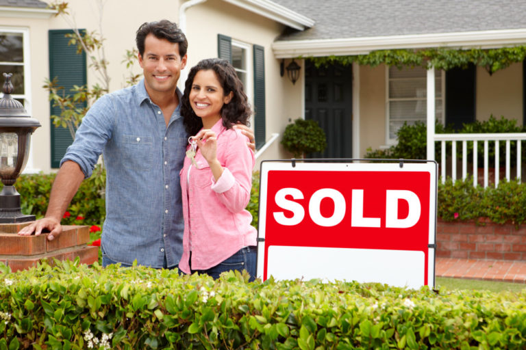 couple with newly bought house