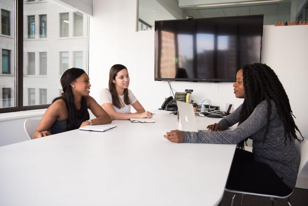 women speaking in a meeting room