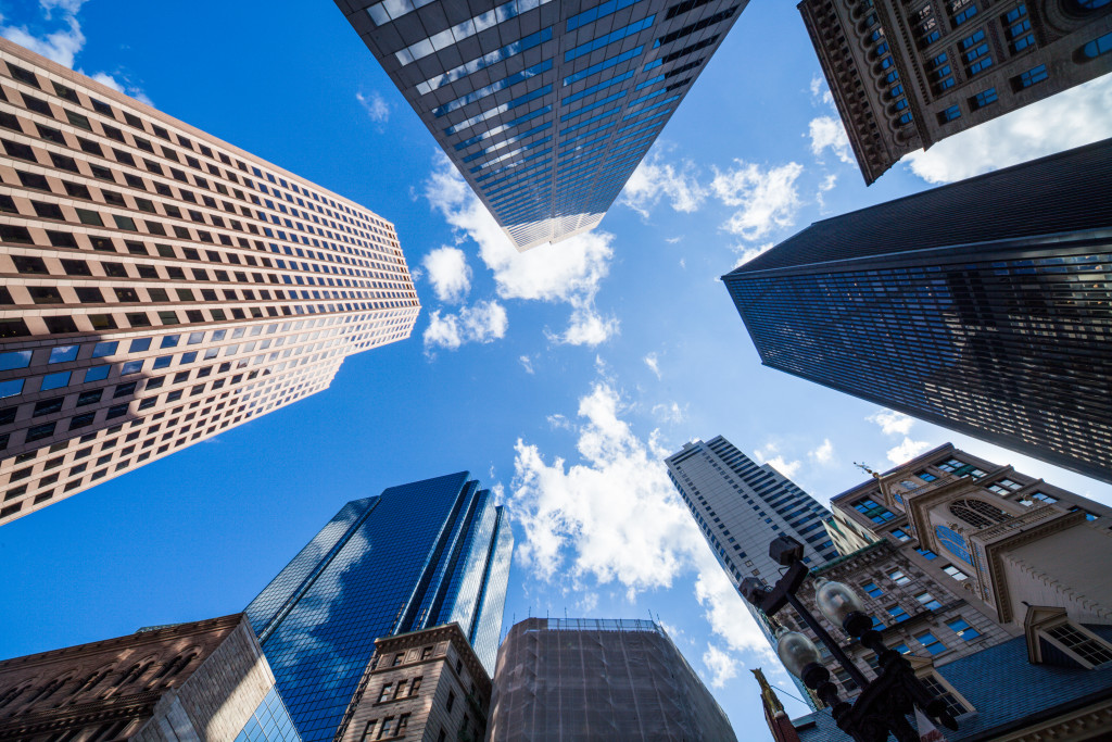 a view of high-rise buildings from below